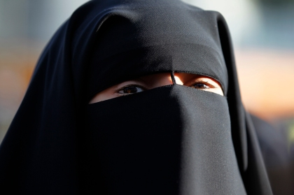 Hind Ahmas wears a niqab despite a nationwide ban on the Islamic face veil outside the courts where she arrived with the intention to pay a fine after she was arrested last May for wearing the niqab in public, in Meaux, east of Paris, on September 22, 2011. Photo courtesy of REUTERS/Charles Platiau*Editors: This photo may only be republished with RNS-FRANCE-NIQAB, originally transmitted on Oct. 20, 2015.