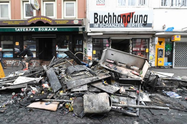 Damage is seen on a street after demonstrations at the G20 summit in Hamburg